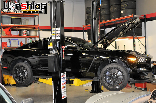 Once your have the S550 camber plates ready, raise the car on a lift which allows the chassis to extend to full droop in the front, like on this 2-post lift (at least get the front end securely off the ground)