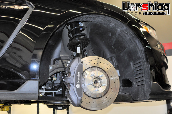 Once the wheels are off remove the brake caliper and rotor. Hang the caliper inside the wheel well area to not stress the brake flex line.