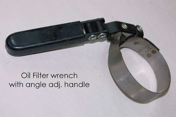"""This tool is sometimes needed for oil filter removal - an """"import style"""" small diameter oil filter removal wrench with an angled handle. Pick one up at any parts store. Don't get the """"large"""" one used for some domestic oil filters."""