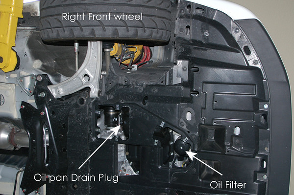 The area you need to get to is near the right front wheel. There is an inspection cover that is made specifically for oil and oil filter changes