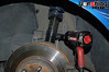 """The OEM endlinks used a 16mm socket. The threaded shaft of the endlink can spin within the end link's ball joint assembly, so a 16mm wrench was put on the """"flats"""" of the end link, behind the swaybar."""