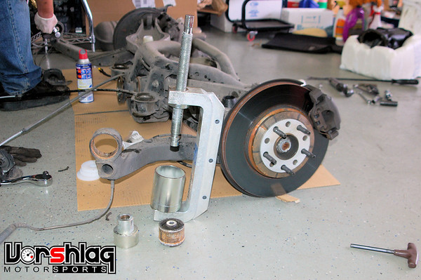 """We cheated and used a BMW-specific bushing removal/installaiton kit. It has a huge C-clamp and all of the proper sized inserts to press the various BMW bushings in and out. Super easy with the right tools.<br /> <br /> If you don't have this you can cut/drill/hammer out the old RTAB bushings, but you will need something to press them in place. You can fasion a tool with some beefy all thread and 2"""" pipe caps. Its """"fun""""."""