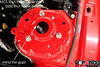 This shows the stock strut tower hole on the S550 generation Mustang. It will always limit inboard camber travel on Vorshlag camber-caster plates.