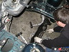 """K-member completely out of the way. The rear """"lollipop"""" mounts for the control arms were unbolted as well, to give maximum room. This way the engine can go in straight, with no need to tilt or angle up and over the K-member. The control arm ball joint nut is also loosened, and later removed completely (the new motor mounts also attached here)."""