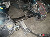 Here a floor jack is used to temporarily hold the K-member in place.