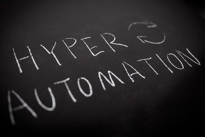Handwriting,Of,Hyper,Automation,In,White,Colour,By,Chalk,On