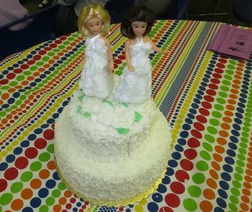 A wedding cake celebration for an 18-year partnership.