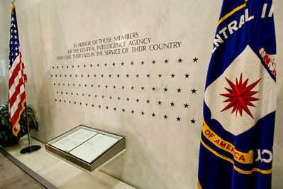 The  Central Intelligence Agency (CIA) Memorial Wall on the north wall of the original Headquarters building lobby in Langley, VA.  The 89 star represent as a silent memorial to CIA officers which made the ultimate sacrifice.  The book below contains names contains but a few names of a few, many will remain secret and have no name listed next to the star and year they died.