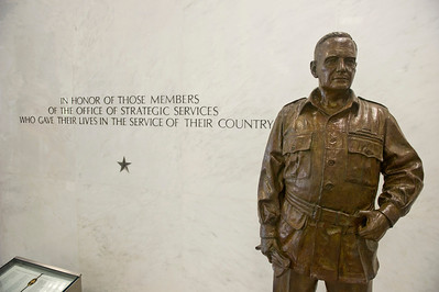 "A statute of General ""Wild Bill"" Donovan, Army general, lawyer and intelligence officer who started the Office of Strategic Services (OSS) stands in the entrance of  the  Central Intelligence Agency Headquarters, which followed in the footsteps of the OSS.  Below is a book listing the names of the OSS operatives that were killed during their missions.  Photo: Greg E. Mathieson Sr. / MAI"