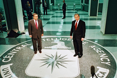 March 20, 2001   Langley, Virginia   President George W Bush stands by  Director of Central Intelligence George Tenet at CIA Headquarters, during a tour of the facility. Pool Photo / MAI