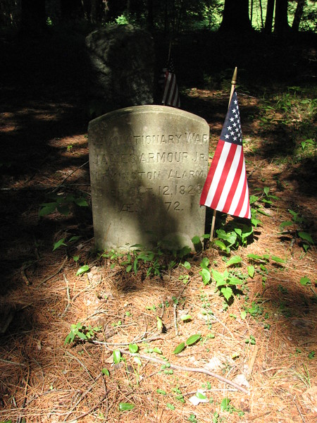 Situated about six feet behind the other stone is this Rev War gravestone.