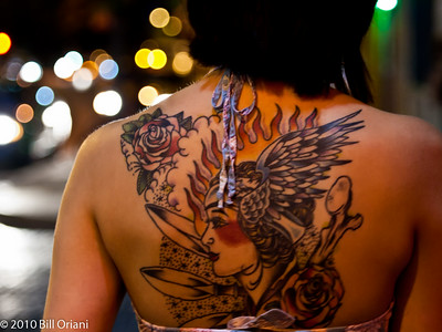 girl with large back tattoo