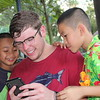 showing iphone to kids in the orphanage