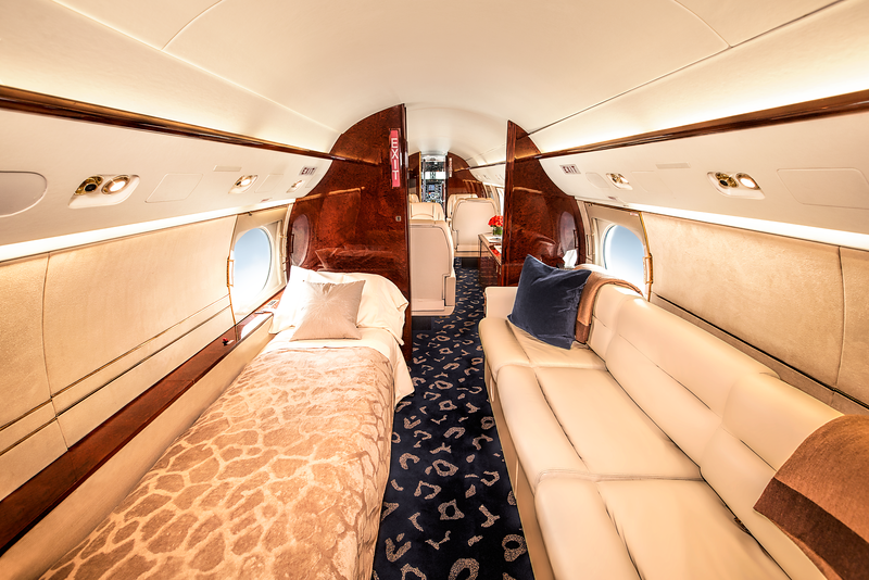 We work hard to ensure that internal lighting properly showcases the amenities of this luxury aircraft interior passenger cabin with ivory wall trim and leather canvased sleeping quartersfor the jetset traveler.