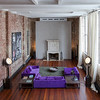 A view of the sun dreched New York City townhouse living room with 20 ft high ceilings, a $250,000 fire place imported from Chateau in the South of France, two Staten Island Ferry spotlights salvaged from a sucken ferry and restored; as seen on HGTV's Million Dollar Rooms.