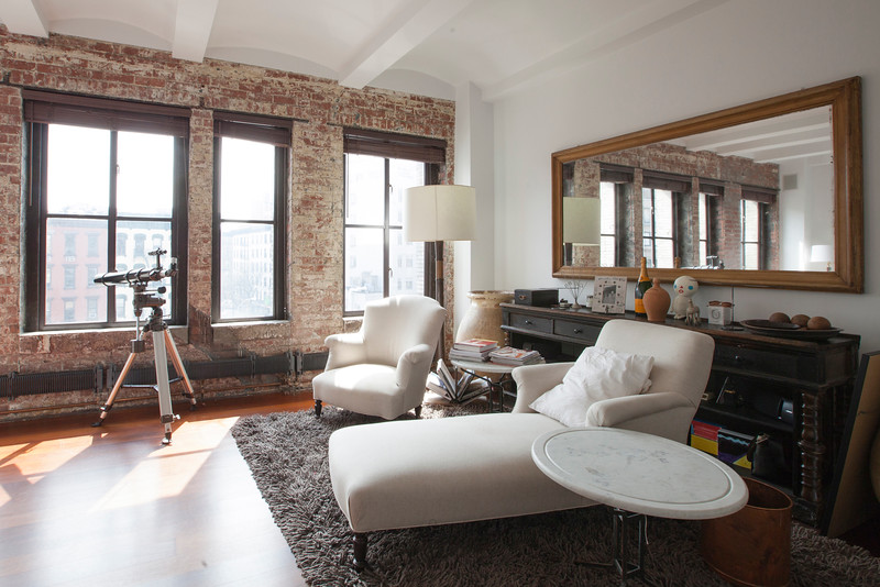 Master bedroom of this unique New York City property.  Overlooking the a SoHo park, this sun drenched bedroom is one of three in this massive townhouse, as seen on HGTV's Million Dollar Rooms.