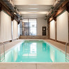 View of the of a private indoor pool found of the second floor of the five story loft house in New York City. This pool is not only unique because it is located on the second floor which is unheard of in New York City for a residential pool of this size, as seen on HGTV's Million Dollar Rooms.