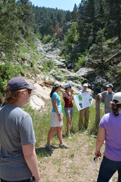RESESS and Geo-Launchpad interns learn from CU graduate students about the hydrogeology of the 2013 Colorado Front Range flood that devastated Boulder County. Boulder Canyon, Boulder, CO, June 18, 2016. (Photo/Aisha Morris, UNAVCO)