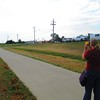 Laura Fakarhai uses the laser range finder on the Pearl Street Bike Path during TLS site planning phase