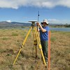 Laura Fakahrai takes height measurements of base station after initial setup.