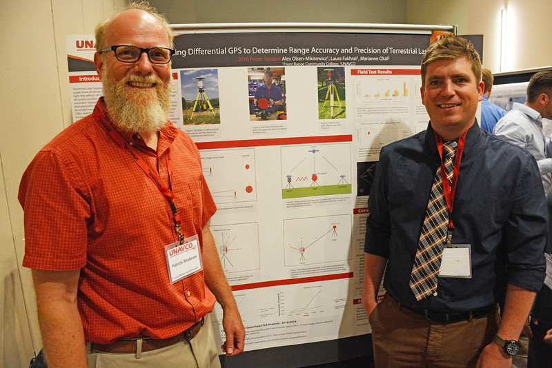 Geo-Launchpad intern, Alex Olsen-Mikitowicz, poses with his faculty mentor, Patrick Shabram, in front of his poster at the end-of-summer poster session at UCAR. Boulder, CO. July 28, 2016. (Photo/Beth Bartel, UNAVCO)