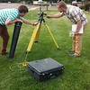 GLP Intern Alex Olsen-Mikitowicz and field engineer Keith Williams make adjustments to the Trimble choke ring GPS at UNAVCO in Boulder, CO.