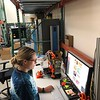 2018 USIP intern Samantha Eckes works in the UNAVCO warehouse with the 3D printer.  July 17, 2018.  Boulder, Colorado.  (Photo/Dylan Schmeelk, UNAVCO)