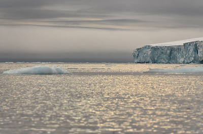 Artic light over glacier cliffs, E side of Cape Fligely, Rudolph Island
