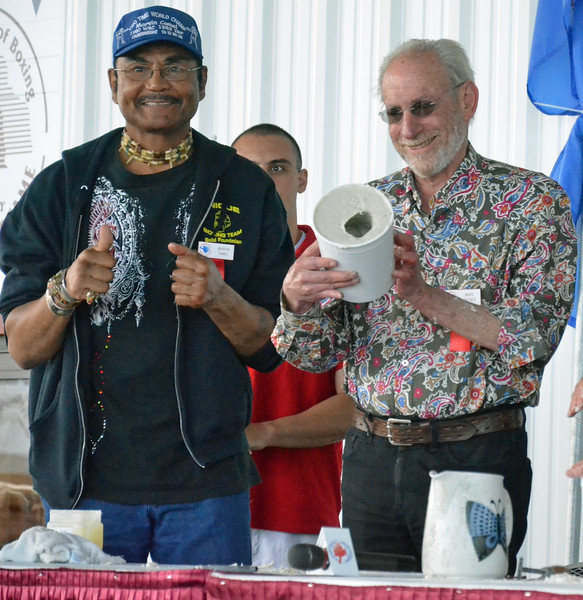 KYLE MENNIG - ONEIDA DAILY DISPATCH Marc Ratnor, right, holds up the mold for his fist casting as Marvin Camel reacts during the International Boxing Hall of Fame's Induction Weekend in Canastota on Friday, June 10, 2016.