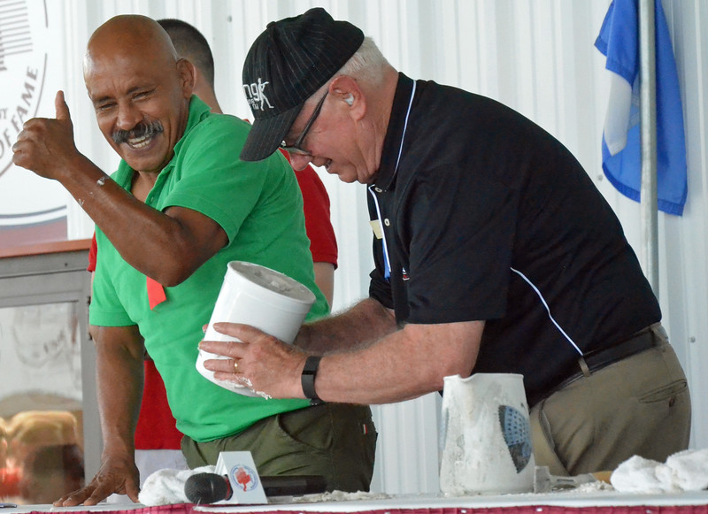 KYLE MENNIG - ONEIDA DAILY DISPATCH Lupe Pintor pulls his fist our of the mold for his fist casting during the International Boxing Hall of Fame's Induction Weekend in Canastota on Friday, June 10, 2016.