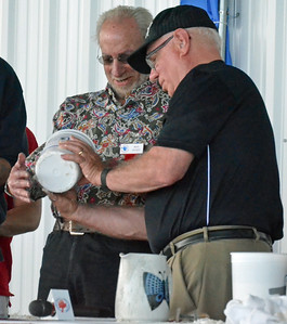 KYLE MENNIG - ONEIDA DAILY DISPATCH John Hunt, right, shows Marc Ratnor the mold for his fist casting as Marvin Camel reacts during the International Boxing Hall of Fame's Induction Weekend in Canastota on Friday, June 10, 2016.