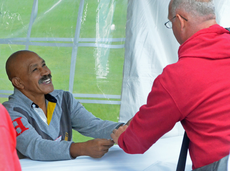 KYLE MENNIG - ONEIDA DAILY DISPATCH Lupe Pintor greets a fan during the International Boxing Hall of Fame's Induction Weekend in Canastota on Thursday, June 9, 2016.