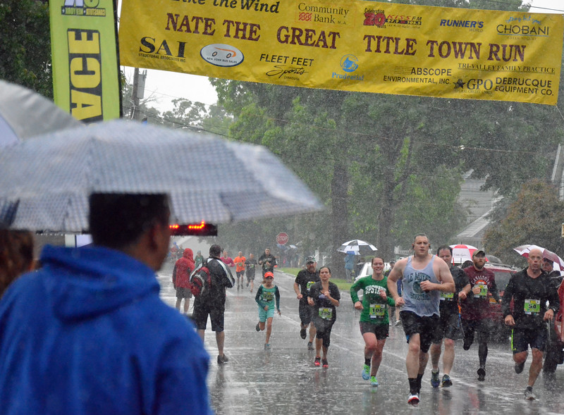 KYLE MENNIG - ONEIDA DAILY DISPATCH Runners cross the finish line of the Nate the Great Title Town 5k Run in Canastota on Saturday, June 11, 2016.