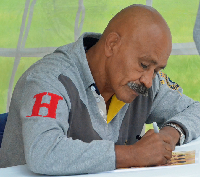 KYLE MENNIG - ONEIDA DAILY DISPATCH Lupe Pintor signs an autograph during the International Boxing Hall of Fame's Induction Weekend in Canastota on Thursday, June 9, 2016.