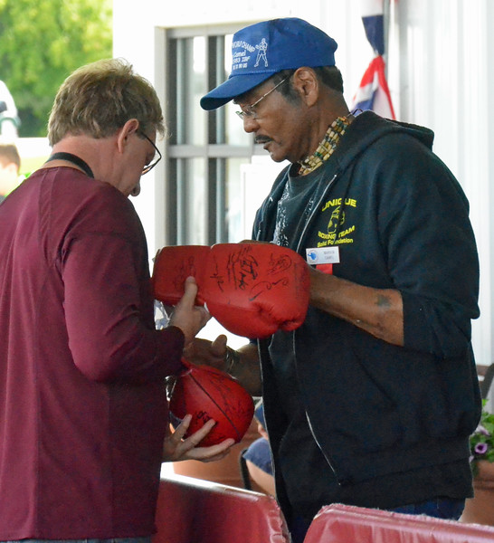 KYLE MENNIG - ONEIDA DAILY DISPATCH Marvin Camel signs autographs during the International Boxing Hall of Fame's Induction Weekend in Canastota on Friday, June 10, 2016.