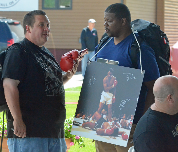 KYLE MENNIG - ONEIDA DAILY DISPATCH Boxing fans talk during the International Boxing Hall of Fame's Induction Weekend in Canastota on Thursday, June 9, 2016.