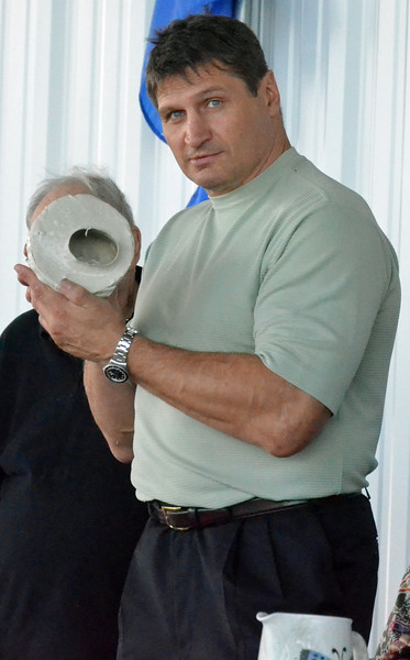 KYLE MENNIG - ONEIDA DAILY DISPATCH Andrew Golota holds up the mold for his fist casting during the International Boxing Hall of Fame's Induction Weekend in Canastota on Friday, June 10, 2016.