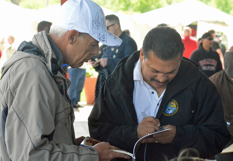 KYLE MENNIG - ONEIDA DAILY DISPATCH Paul Gonzales, right, signs an autograph during the International Boxing Hall of Fame's Induction Weekend in Canastota on Thursday, June 9, 2016.