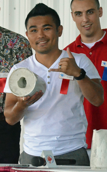 KYLE MENNIG - ONEIDA DAILY DISPATCH Brian Viloria holds up the mold for his fist casting during the International Boxing Hall of Fame's Induction Weekend in Canastota on Friday, June 10, 2016.