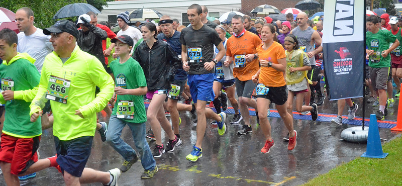 KYLE MENNIG - ONEIDA DAILY DISPATCH Runners leave the start line of the Nate the Great Title Town 5k and 12k Runs in Canastota on Saturday, June 11, 2016.