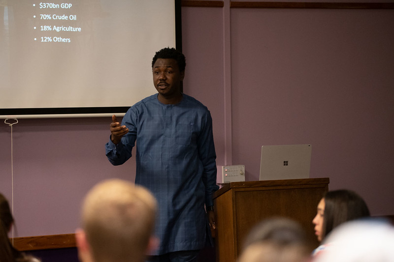 Coffee Hour is a culturally enriching experience held at the International Student Center at K-State. Today, Onyedika Ekwerike informed the open public about Nigeria culture, population, religion and economy. Sept 27, 2019. (Dylan Connell | Collegian Media Group)