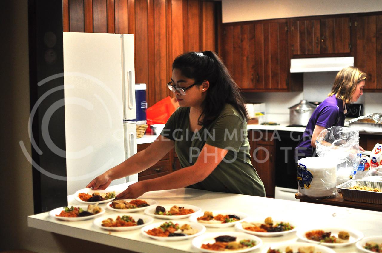 Savannah Rattanavong Senior in Journalism and Mass Communications, prepares food for Internation Coffee Hour in Manhattan, Kan. Spetember 22, 2017 (Blake Reid | Collegian Media Group)