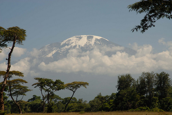 Kilimanjaro, the worlds largest free standing mountain.  It is the highest mountain in Africa at 19,340 (5895m) and the only place one can pass through five temperate zones in five days starting in a jungle and ending in an alpine environment.