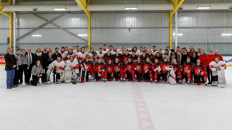 December 31, 2017 - Calgary, AB - Canada's National Women's Olympic Team and Hungary's National U18 Men's Team group photo after their exhibition hockey game.