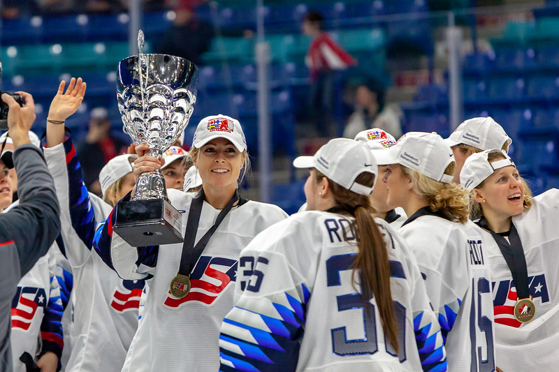 November 10, 2018 - Saskatoon, SK - Gigi Marvin holds the 2018 Four Nations Cup Trophy as Team USA celebrates their gold medal win.