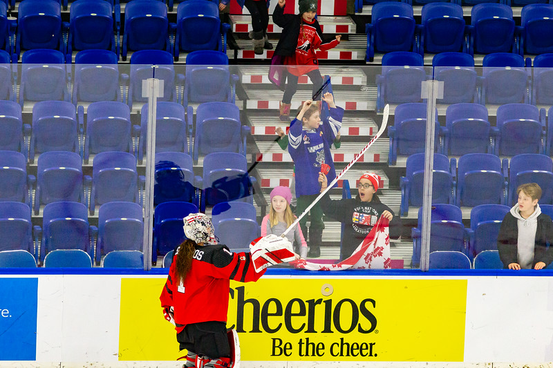 November 9, 2018 - Saskatoon, SK - Shannon Szabados gives a young fan her goal stick after the end of the Team Canada and Team Finland preliminary game at the Four Nations Cup. Team Canada won this game 3-0.