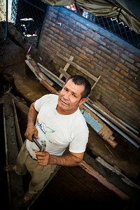 Volunteer church construction worker builds foundation for CIV funded bathrooms