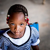 A young girl sits in time-out during activities at one of Compassion's implementing church partners