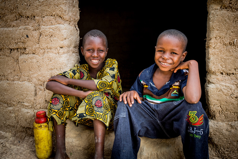Sayouba, sibling of a Compassion registered child, rural Burkina Faso, and Compassion registered child, Issouf Diallo (blue shirt)