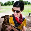 Aveleen Schinkel, Compassion Canada, holds a baby goat, behind the scenes